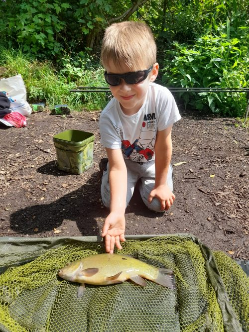 Catching A Tench On His New Rod